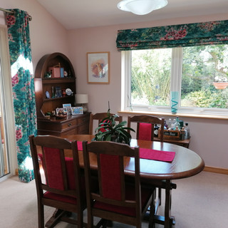 Eyelet curtains and roman blind