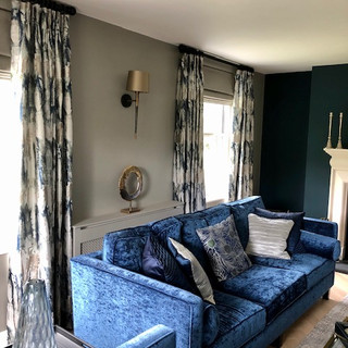 Pinch pleat curtains and Roman blinds