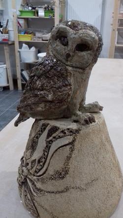 Owl stuck to somebody elses vase....