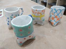 Three legged mugs made with our autistic