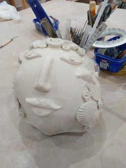 Wall hanging face pot