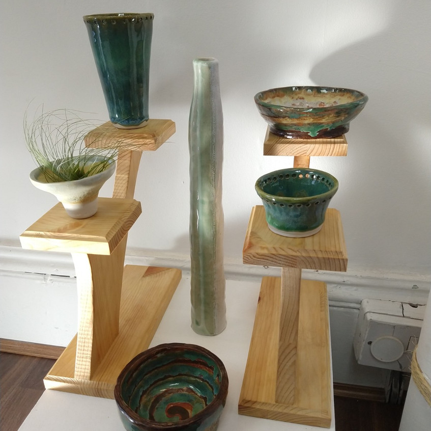 small pots on a stand