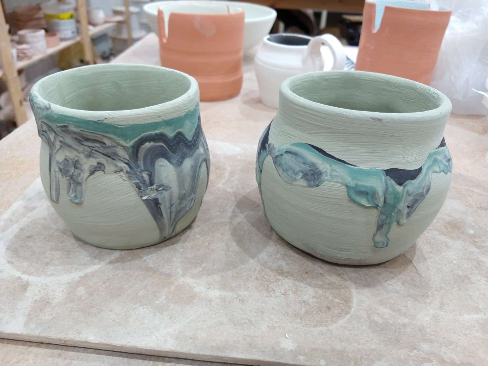 Mixed slip poured on pot
