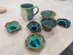 A slip cast mug and small bowls with gla