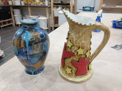 Slip decorated vase and hand built jug