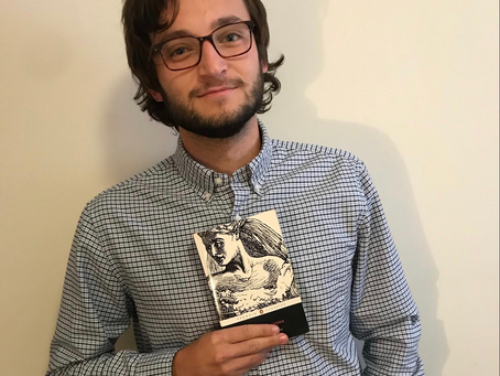 English Major Indistinguishable from Beaten Paperback Book He's Holding