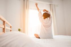 woman stretching waking up
