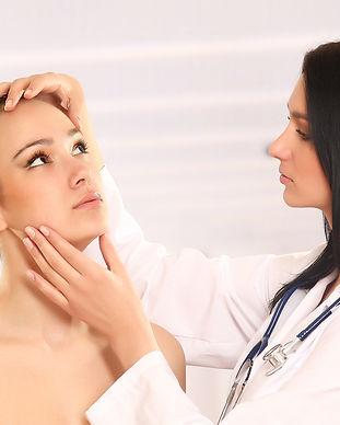 bigstock-Pretty-doctor-examining-beauti-