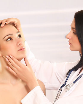 bigstock-Pretty-doctor-examining-beauti-