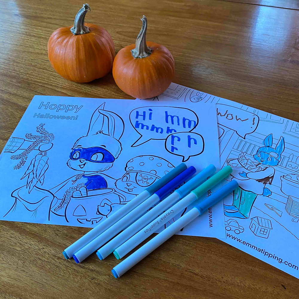 A set of blue markers and cute baby pumpkins frame a free halloween coloring page