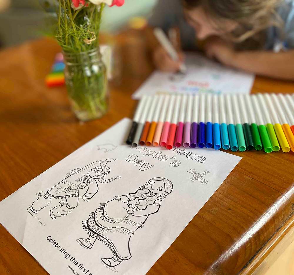 Photo of a peaceful scene, where a little girl is coloring in a coloring page with Crayola markers.