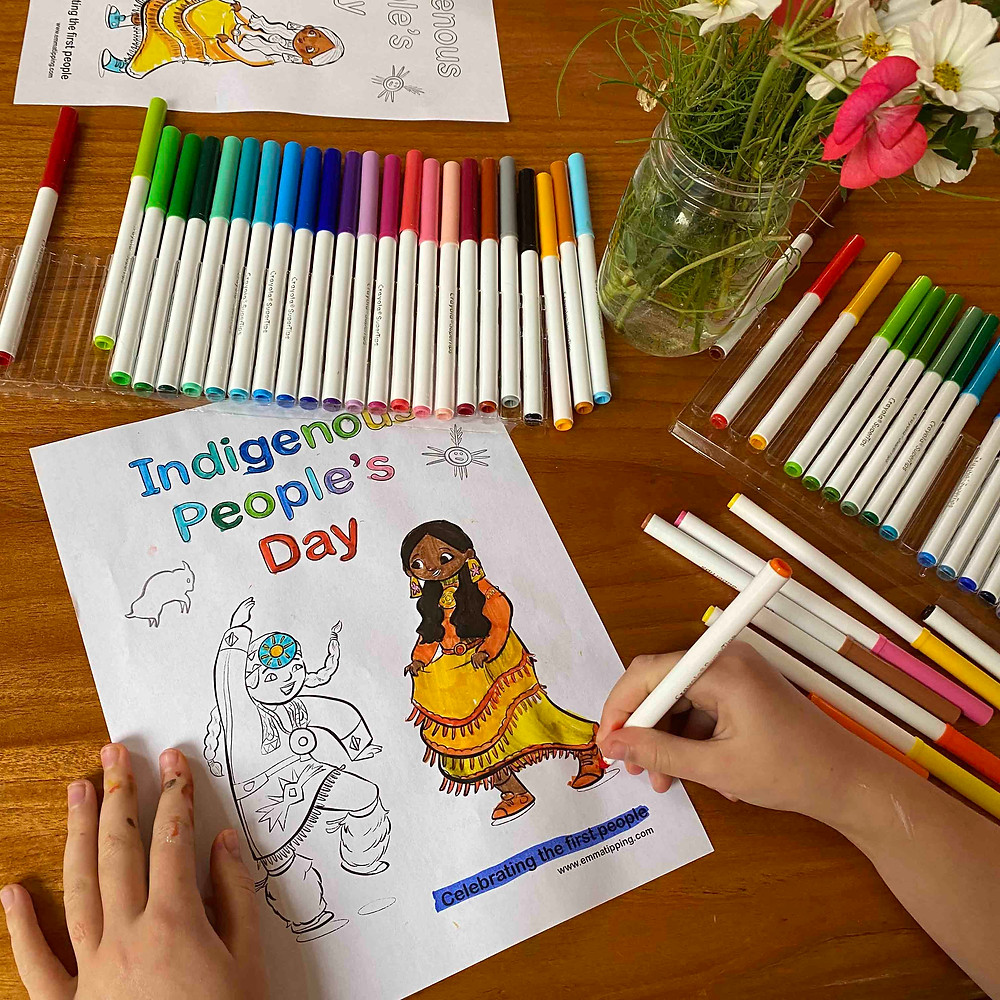Child applying red marker to a coloring page celebrating Indigenous Peoples' Day.