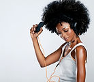 Happy african woman with afro and casual