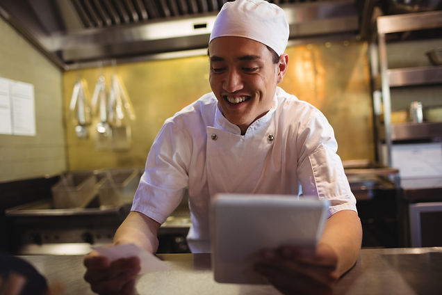 chef-looking-at-an-order-list-in-the-com