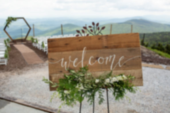 Wedding signs and wood arbor