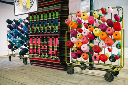 kaboompics_Big colorful Spool of Thread
