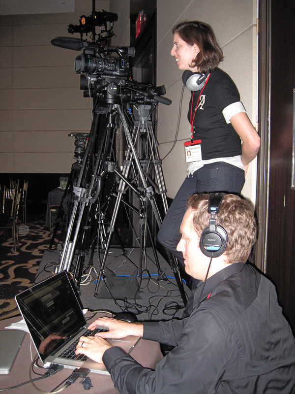 Anneliese Paull manning the camera. Chris Soucey on the laptop.