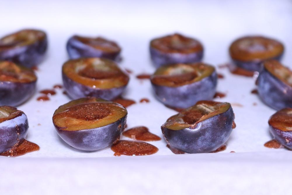 Roasted plums with cinnamon nutmeg and orange brandy