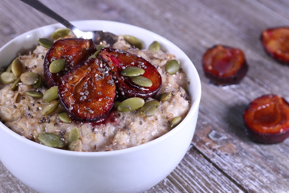 Gluten-free Oats with Roasted Plums and Pumpkin Seeds