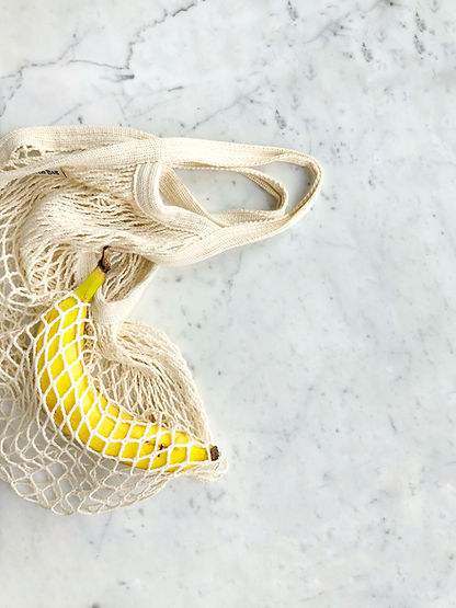 Canva - Ripe Banana in White Knitted Bag