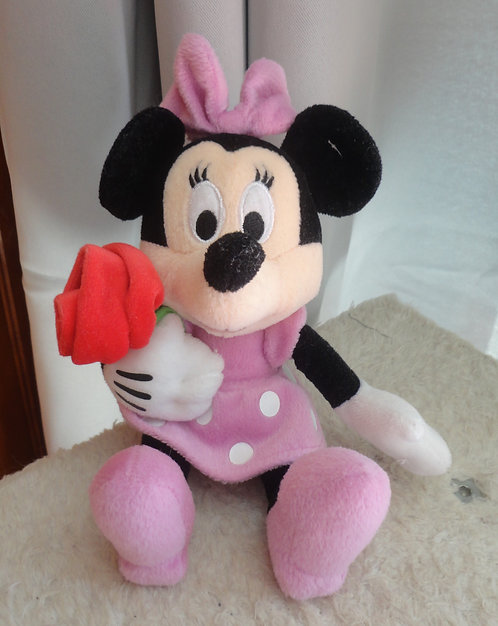 Peluche Disney Minnie Mouse tenant rose rouge .