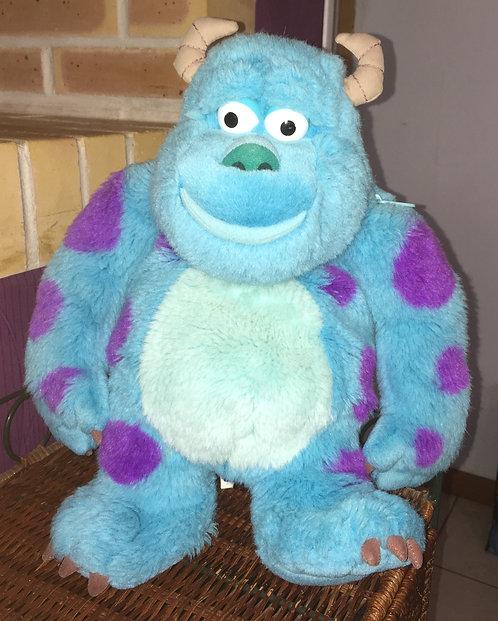 Peluche Sulli Disney Monstres & Cie range pyjama.