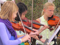 Violin students at outreach performance