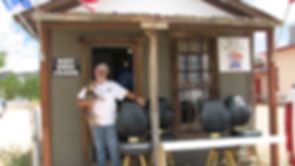 Owner Mike Wurdeman with a selection of chairs available at Miner's Shack Mercantile in Chloride, Arizona.