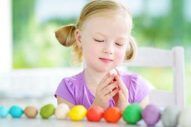 Cute little girl having fun with colorfu