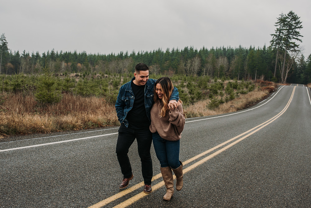 Couple Walking in the road during their Engagement session by Cherish Shanell Photography