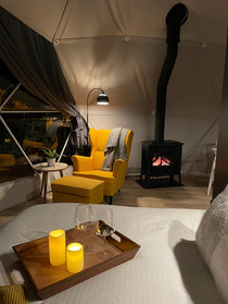 Relax next to the warm stove with your feet up and gaze over a spectacular view of seemingly endless coniferous trees.