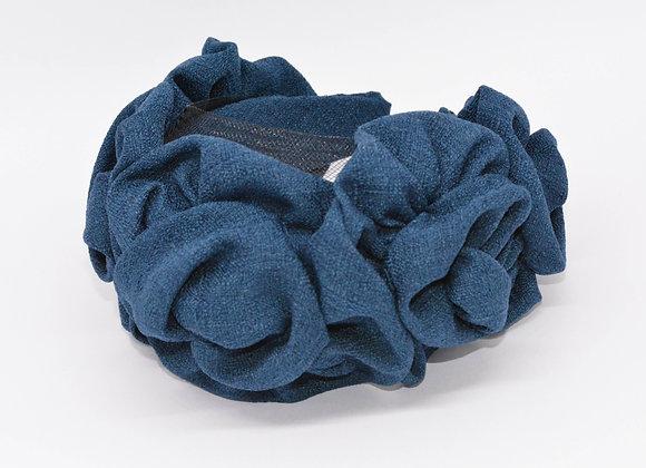 Blue fabric floral swirl hairband.