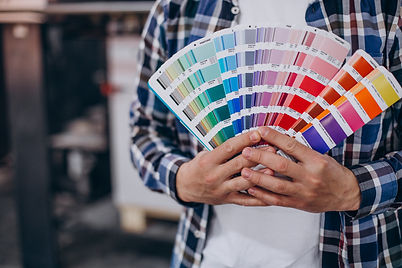 man-working-printing-house-with-paper-paints.jpg