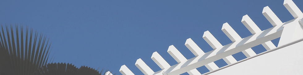 UX Design Header Image. Blue sky with palm trees in silhouette and terraced white roof.