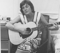 Constance Curry playing the guitar