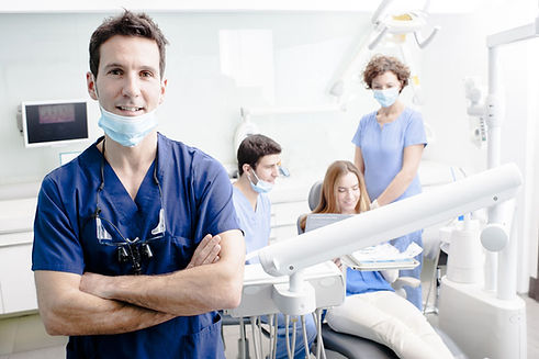 A picture of a dentist at dentistry with care mortdale