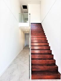 Guilford Duplex- Stairs-Hall.jpg