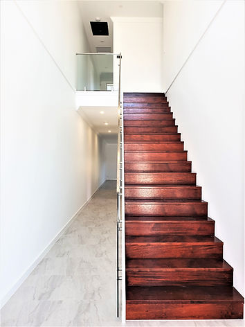 Guilford Duplex- Stairs-Hall.jpg