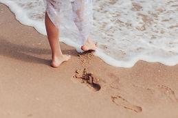 Feet of the bride on the beach