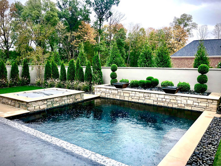 Updated landscape and hardscape around at this modern home is Goshen, Kentucky