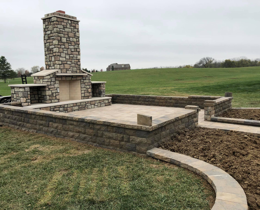 OUTDOOR FIREPLACE, PAVER PATIO, AND FEESTANDING SEATING WALLS