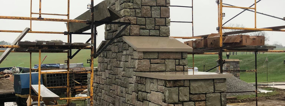 FINISHED STONEWORK ON THE OUTDOOR FIREPLACE