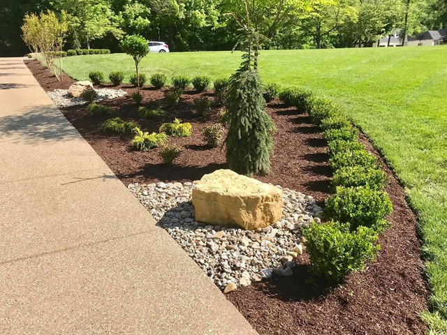 Landscape bed on the driveway