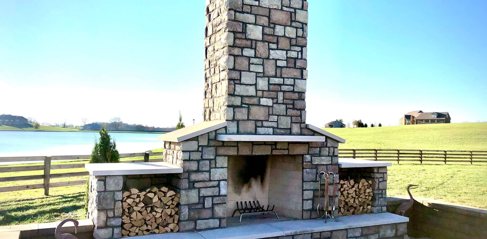 THE FINISHED OUTDOOR FIREPLACE WITH WOODBOXES AND HEARTH