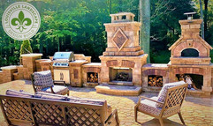 Outdoor Kitchen, fireplace, and pizza oven on a paver patio