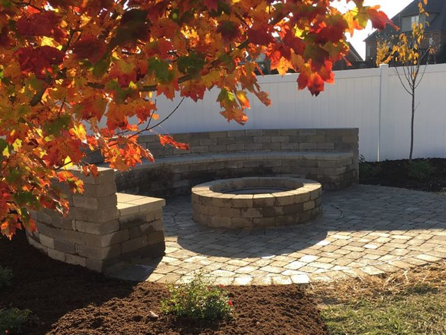 Firepit with paver hardscape bench and patio