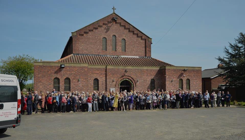 Gathered outside church (pre Covid)