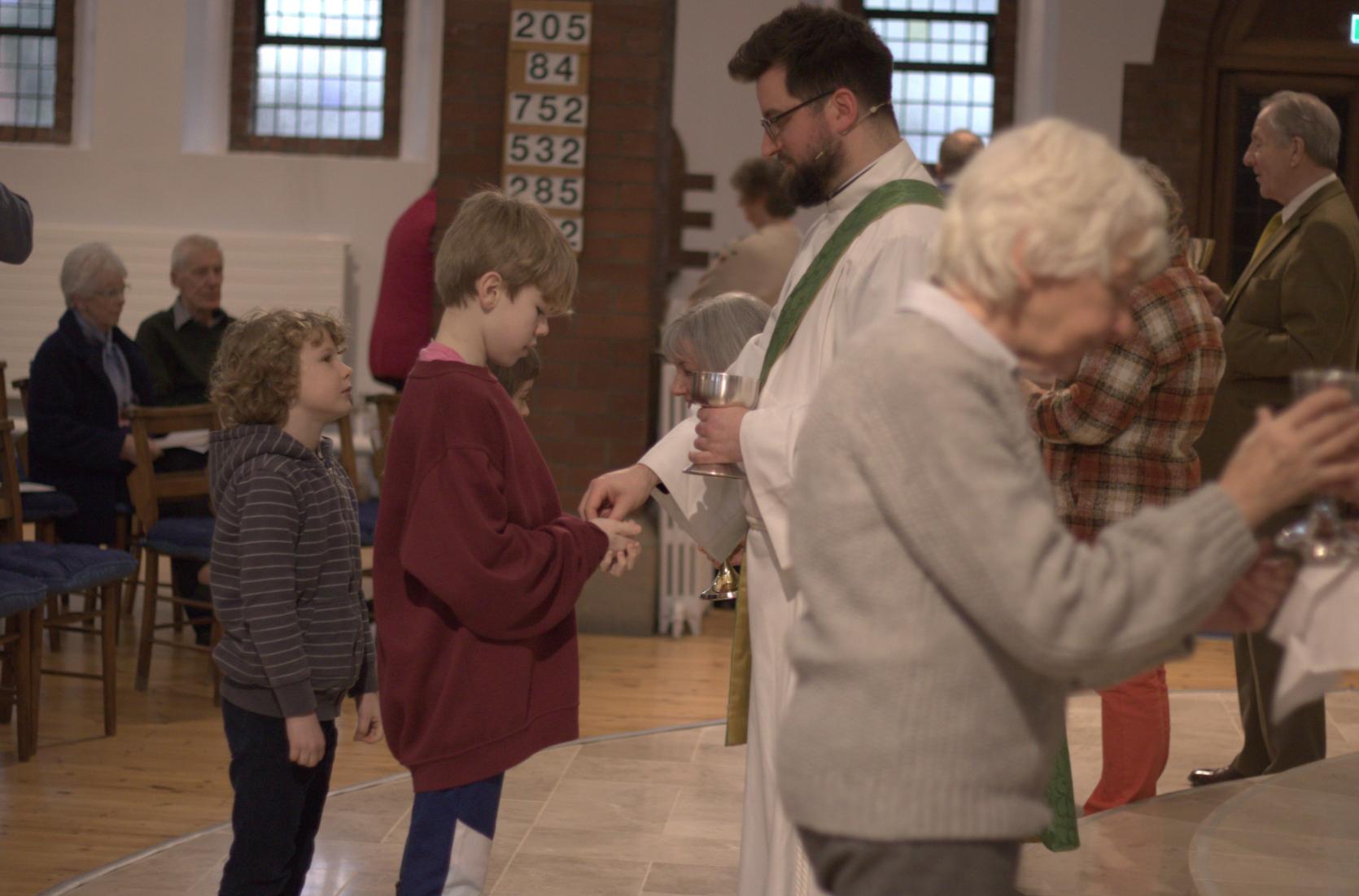 children come forward for communion
