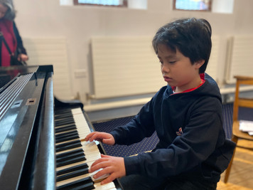 Young musician on our grand piano