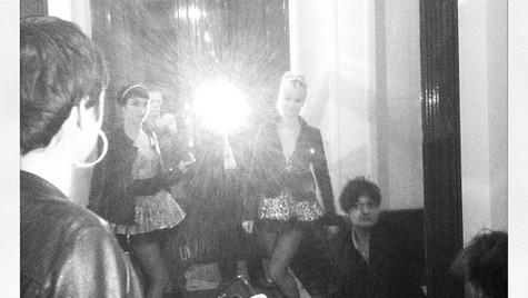 Peter, Celine and Octavie in a dressing room.